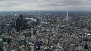 AX114_045 - 6K stock footage aerial video approach 20 Fenchurch skyscraper near the river and The Shard, Central London, England