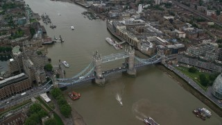 AX114_050 - 6K stock footage aerial video approach Tower Bridge over River Thames as cars cross the span, London, England
