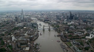 AX114_053 - 6K stock footage aerial video of Central London city sprawl and Tower Bridge over River Thames, England