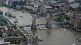 AX114_055 - 6K stock footage aerial video of Tower Bridge over River Thames near Tower of London, Central London, England