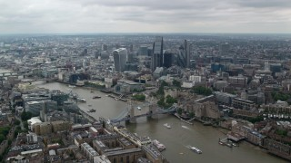 AX114_058 - 6K stock footage aerial video approach Tower Bridge, Tower of London and River Thames, Central London, England