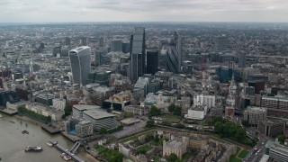 AX114_060 - 6K stock footage aerial video of approaching skyscrapers from River Thames, Central London, England