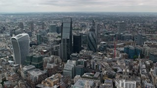 AX114_061 - 6K stock footage aerial video approach The Gherkin and Central London skyscrapers, England