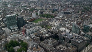 AX114_064 - 6K stock footage aerial video fly over office buildings, approach Artillery Ground and Finsbury Square, Central London, England