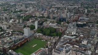 AX114_065 - 6K stock footage aerial video fly over Artillery Ground cricket field and office buildings, Central London, England