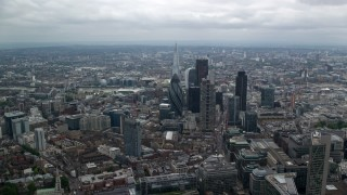 AX114_070 - 6K stock footage aerial video approach tall skyscrapers and The Shard, Central London, England