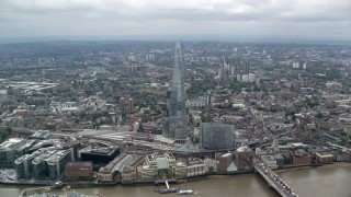 AX114_075 - 6K stock footage aerial video approach The Shard skyscraper from the river, London, England