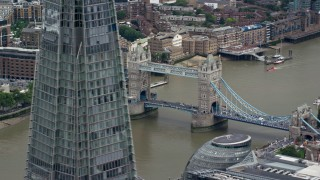 AX114_080 - 6K stock footage aerial video of Tower Bridge over River Thames, seen from The Shard, London, England