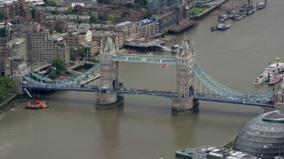 AX114_081 - 6K stock footage aerial video of light traffic on Tower Bridge spanning the River Thames, London, England