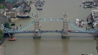 AX114_082 - 6K stock footage aerial video of the Tower Bridge spanning the River Thames, London, England