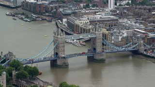 AX114_084 - 6K stock footage aerial video of orbiting Tower Bridge spanning River Thames, London, England