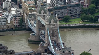 AX114_089 - 6K stock footage aerial video of circling the Tower Bridge, London, England