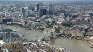 AX114_095 - 6K stock footage aerial video of Tower Bridge and Tower of London, skyscrapers in background, Central London, England