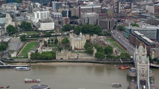 AX114_097 - 6K stock footage aerial video of orbiting Tower of London by River Thames and Tower Bridge, England