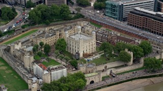 AX114_100 - 6K stock footage aerial video of flying by the iconic Tower of London, England