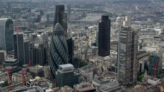 AX114_107 - 6K stock footage aerial video of orbiting The Gherkin and Heron Tower skyscrapers, Central London, England