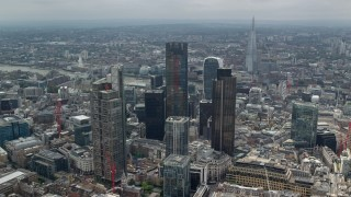 AX114_111 - 6K stock footage aerial video of circling the skyscrapers in Central London, England, The Shard in the background