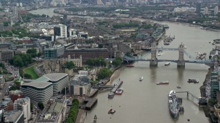 AX114_116 - 6K stock footage aerial video of historic Tower of London, and Tower Bridge on River Thames, England