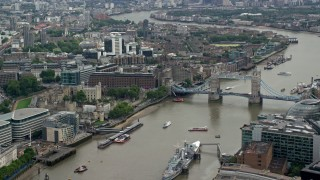 AX114_117 - 6K stock footage aerial video of Tower of London, and iconic Tower Bridge on the River Thames, England