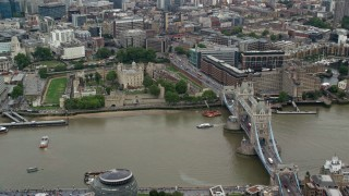 AX114_121 - 6K stock footage aerial video of Tower of London with view of Tower Bridge and River Thames, England