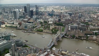AX114_122 - 6K stock footage aerial video of the Tower of London, Tower Bridge and view of skyscrapers, England