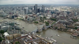 AX114_123 - 6K stock footage aerial video wide view of Tower Bridge near Tower of London and Central London skyscrapers, England