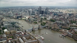 AX114_124 - 6K stock footage aerial video of the Tower Bridge and Central London skyscrapers near the river, England
