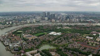 AX114_126 - 6K stock footage aerial video approach Canary Wharf and River Thames, London, England