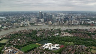 AX114_127 - 6K stock footage aerial video approach Canary Wharf skyscrapers and River Thames, London, England
