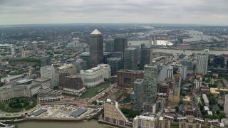 AX114_130 - 6K stock footage aerial video of Canary Wharf skyscrapers, London, England