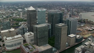 AX114_132 - 6K stock footage aerial video of passing skyscrapers in Canary Wharf, London, England