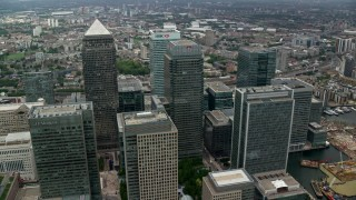 AX114_133 - 6K stock footage aerial video of orbiting skyscrapers in Canary Wharf, London, England