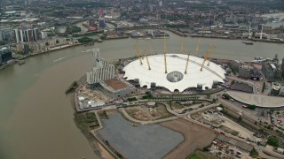 AX114_136 - 6K stock footage aerial video of the O2 overlooking the River Thames, London, England