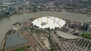 AX114_137 - 6K stock footage aerial video of the O2 Arena by the River Thames, London, England
