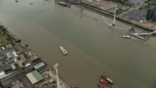 AX114_142 - 6K stock footage aerial video of Emirates Air Line gondolas over River Thames, London, England