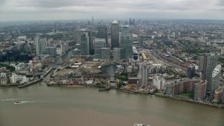 AX114_148 - 6K stock footage aerial video approach Canary Wharf skyscrapers, London, England
