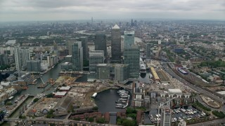 AX114_149 - 6K stock footage aerial video of an approach to Canary Wharf skyscrapers, London, England