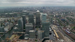AX114_150 - 6K stock footage aerial video of an approach to Canary Wharf skyscrapers, London, England