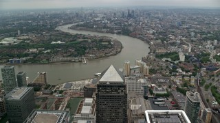 AX114_152 - 6K stock footage aerial video fly over Canary Wharf skyscrapers toward River Thames, London, England
