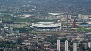 AX114_154 - 6K stock footage aerial video of Olympic Stadium, a soccer stadium in London, England