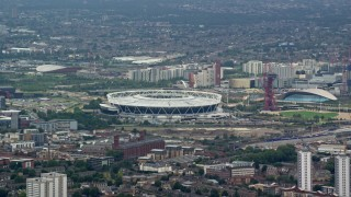 AX114_155 - 6K stock footage aerial video of a view of Olympic Stadium, London, England