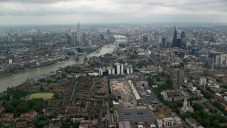 AX114_157 - 6K stock footage aerial video approach The Shard and Central London skyscrapers by River Thames, England