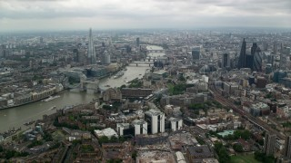 AX114_158 - 6K stock footage aerial video approach The Shard and River Thames bridges in London, England