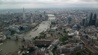AX114_159 - 6K stock footage aerial video of approaching bridges over the River Thames and The Shard skyscraper in London, England