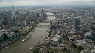 AX114_160 - 6K stock footage aerial video follow River Thames toward London Bridge and The Shard, England