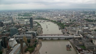 AX114_163 - 6K stock footage aerial video approach bridges while flying over River Thames, London, England