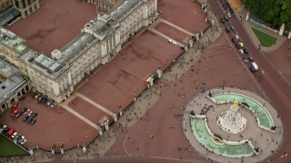 AX114_172 - 6K stock footage aerial video of a bird's eye of Buckingham Palace and tourists, London, England