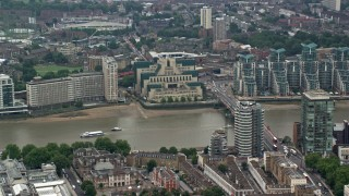 AX114_173 - 6K stock footage aerial video of MI6 Building across the River Thames; London, England