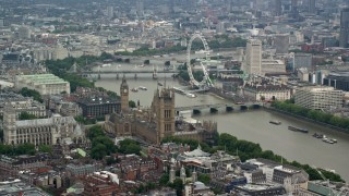 AX114_175 - 6K stock footage aerial video of Big Ben, Parliament, and London Eye beside the River Thames, England