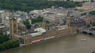 AX114_178 - 6K stock footage aerial video of an orbit of Big Ben and Parliament along River Thames, London, England
